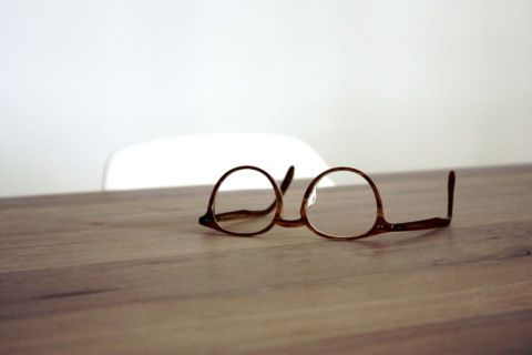 Pair of spectacles on desk